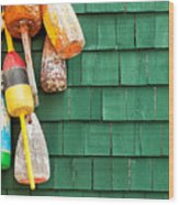 Lobster Buoys Hanging On A Green Wood Wood Print