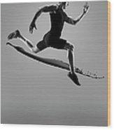 Male Athlete Running Above Liquid Splash Wood Print
