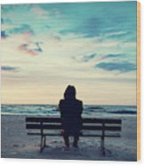 Man In Hood Sitting On A Lonely Bench On The Beach Wood Print