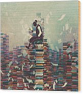 Man Reading Book While Sitting On Pile Wood Print