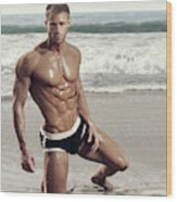 Muscular Model On Beach Wood Print
