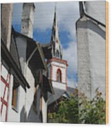 old historic church spire and houses in Ediger Germany Wood Print