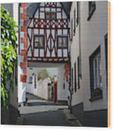 old historic street and woodframed house in Ediger Germany Wood Print