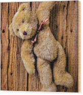 Old Teddy Bear Hanging On The Door Wood Print