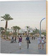 People Walking On Stone Plaza Near Palm Wood Print