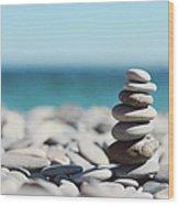 Pile Of Stones On Beach Wood Print