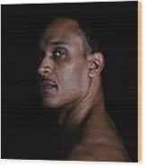 Portrait Of A Man On A Black Background Wood Print