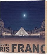 Poster Of  The Louvre Museum At Night With Moon Above The Pyrami Wood Print