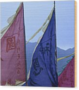Prayer Flags To The Sea Goddess Blow In Wood Print