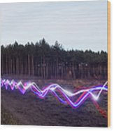 Red, Blue And White Light Trails On Wood Print