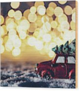 Red Car With Christmas Tree Driving Through Snow Wood Print