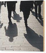 Shadow Team Of Commuters Walking On Wood Print