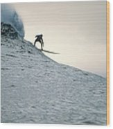 Silhouette Of A Surfer Riding A Wave Wood Print