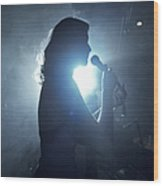 Silhouette Of Woman Using Microphone Wood Print