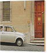 Small Coupe Parked Near A Doorway On A Wood Print