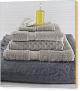 Stacks Of Folded Towels With A Bar Of Wood Print