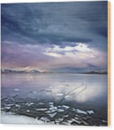 Storm Clouds Clearing Over Icy Lake Wood Print