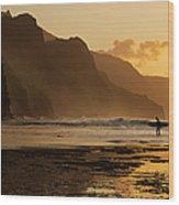 Surfer On Beach And Na Pali Coast Seen Wood Print