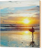 Surfer On The Ocean Beach At Sunset On Wood Print