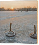 Two Bavarian Curling Stones On A Frozen Wood Print