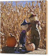 Two Cute Scarecrows With Pumpkins In The Dry Corn Field Wood Print