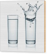 Two Glasses Of Water, One With Splashes Wood Print