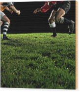 Two Opposing Rugby Players, One Holding Wood Print