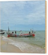 Two Thai Fishermen Take Equipment Onto Boat At Seaside Pattani Thailand Wood Print
