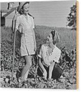 Two Women Gardening In Field Wood Print