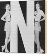Two Women With Huge Letter N Wood Print