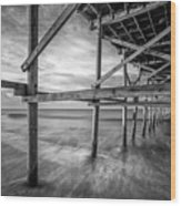 Uner The Pier In Black And White Wood Print