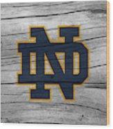 University Of Notre Dame Fighting Irish Logo On Rustic Wood Wood Print