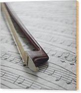 Violin Bow On Music Sheet Wood Print