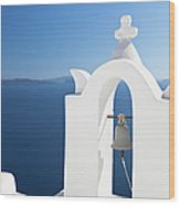 White Bell Tower And Blue Sea Wood Print
