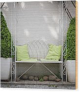 White Bench Made Of Iron With Two Green Bushes On The Side Wood Print