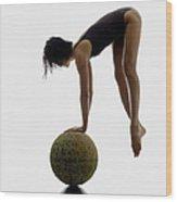 Woman Balancing On Globe Wood Print