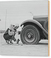 Woman Changing Flat Tire On Car Wood Print