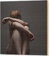 Woman Crouched On Floor Wood Print