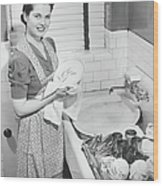 Woman Drying Dishes At Kitchen Sink Wood Print