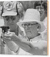 Woman Practicing Firing A Gun Wood Print