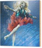 Woman Reaching Underwater Wood Print