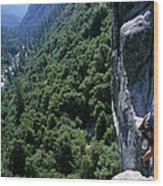 Woman Rock Climbing High Above River Wood Print