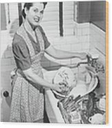 Woman Washing Dishes In Kitchen Sink Wood Print