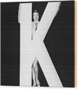 Woman With Huge Letter K Wood Print
