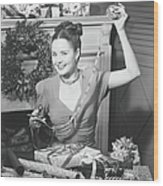 Woman Wrapping Christmas Presents In Wood Print