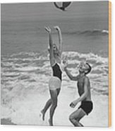 Young Couple Playing With Beach Ball At Wood Print
