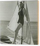 Young Woman Posing On Sailboat Wood Print
