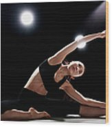Young Woman Stretching Wood Print