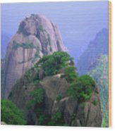 A Rocky Outcropping Overlooks A Mist-covered China Mountain Range Wood Print