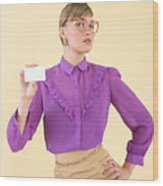 A woman holding a business card Wood Print